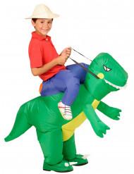 Disfarce explorador às costas de um dinossauro criança