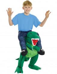 Disfarce menino as costas de um dinossauro criança